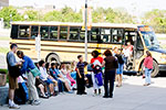 Students at bus drop-off